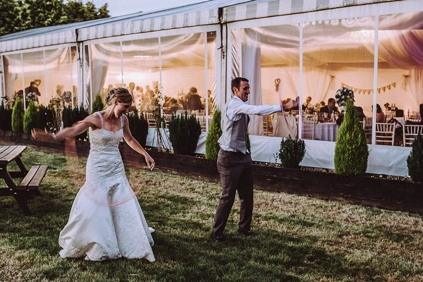 Bride and groom hula hooping