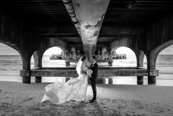 Couple under pier - Picture by Libra Photographic