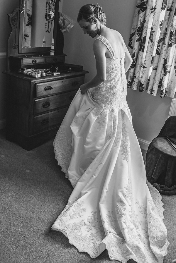 Bride wearing wedding dress with long train