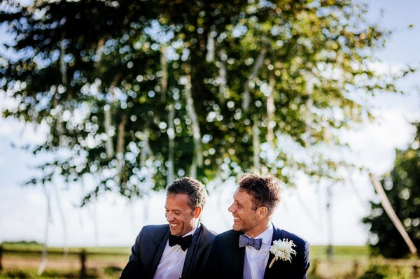 Grooms Bas and Lars laughing at their wedding