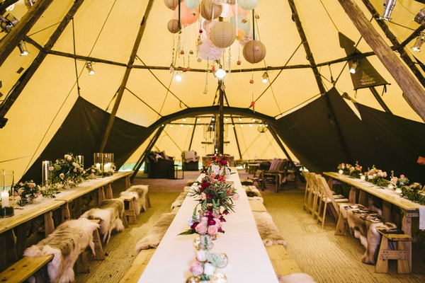 Long benches in wedding tipi
