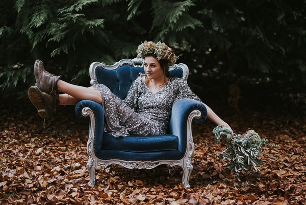 Bride in boots sitting on chair