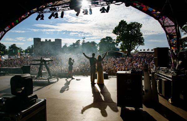 Bride and groom on stage at Camp Bestival - Picture by Libra Photographic