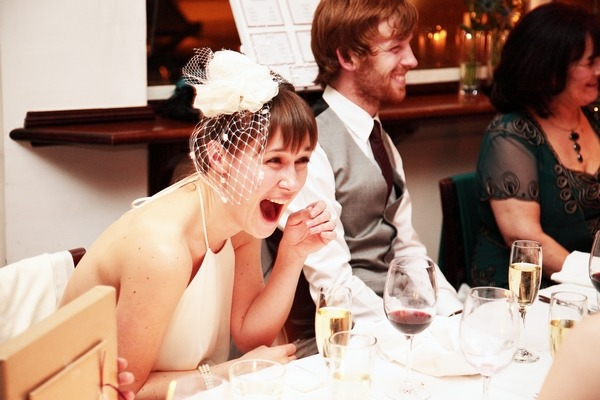 Bride laughing at funny best man speech