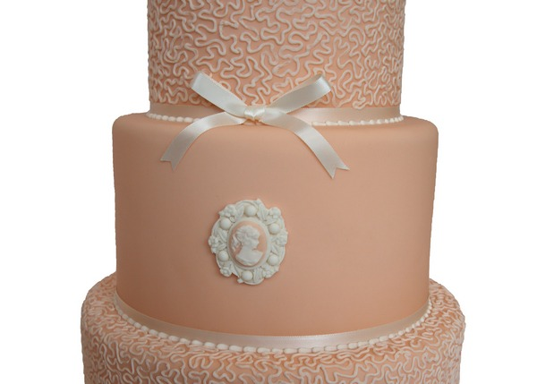 Wedding cake with sugar paste brooch