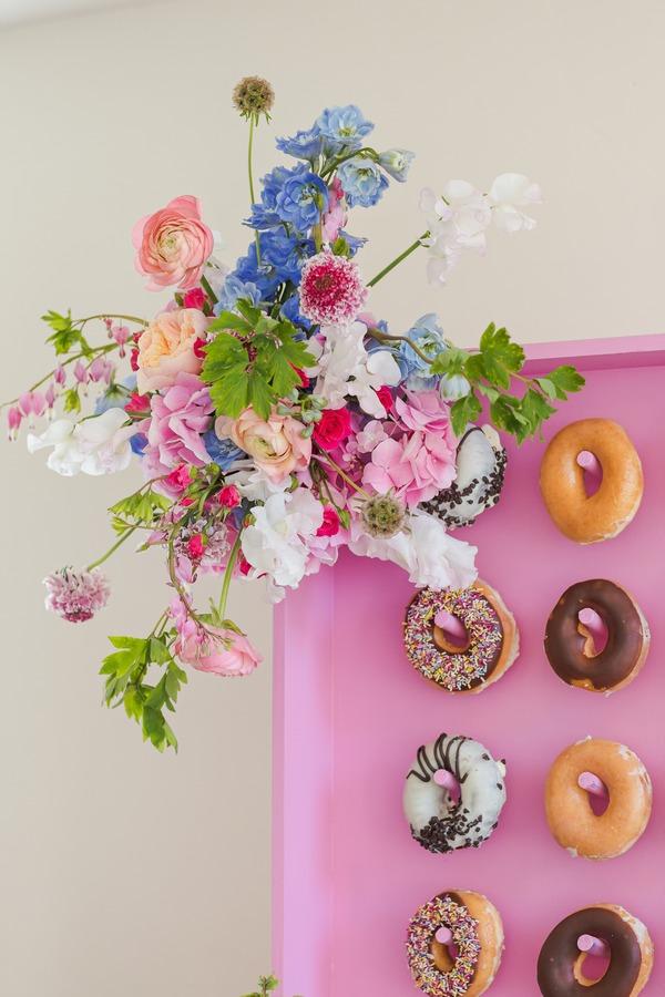 Bright flowers on corner of doughnut wall