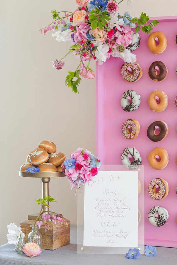 Cake stand of doughnuts and sign