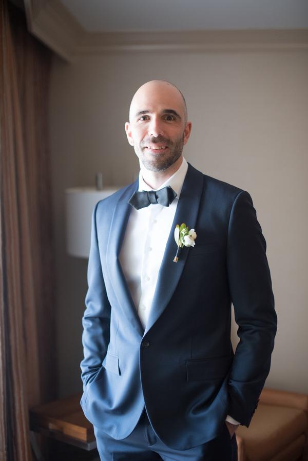 Groom wearing bow tie