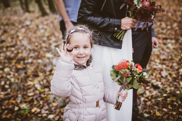 Flower girl holding conker