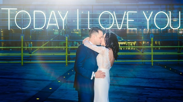 Bride and groom kissing in front of neon sign that says Today I Love You - Picture by Mick Cookson Photography