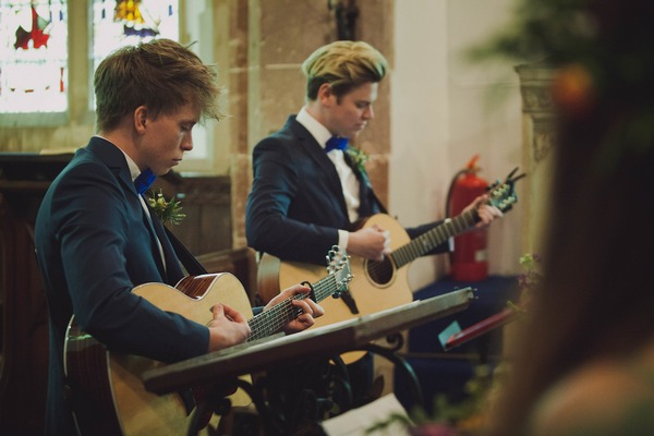 Guitarists playing during church wedding ceremony