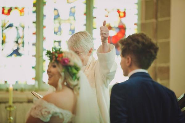 Vicar giving thumbs up