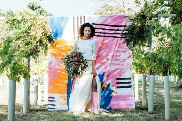 Bride standing against a colourful backdrop