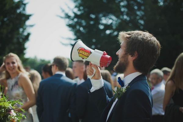 Man using megaphone at wedding