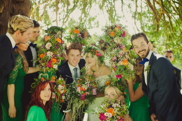 Bridal party posing with flowers