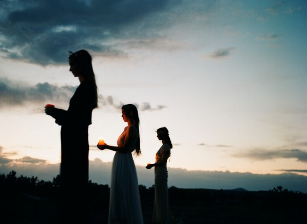 Silhouettes of brides at night