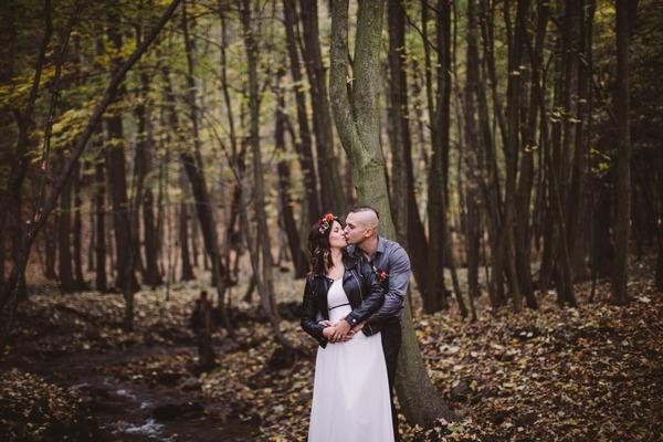 Groom kissing bride from behind