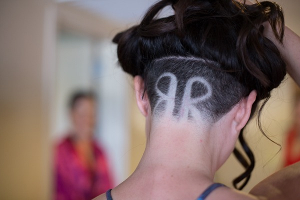 Bride and groom's initials shaved in back of bride's head