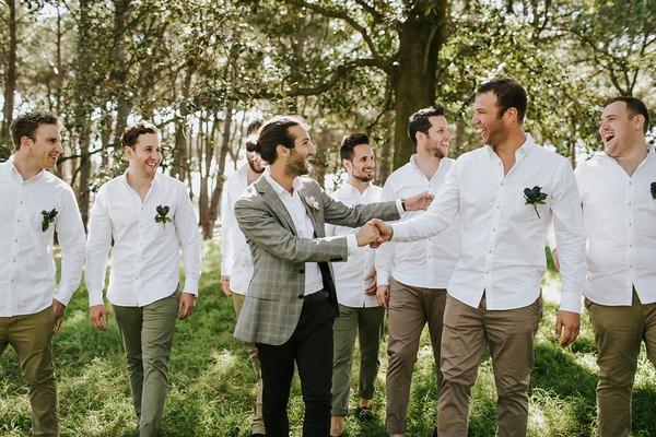 Groom shaking hands with groomsman