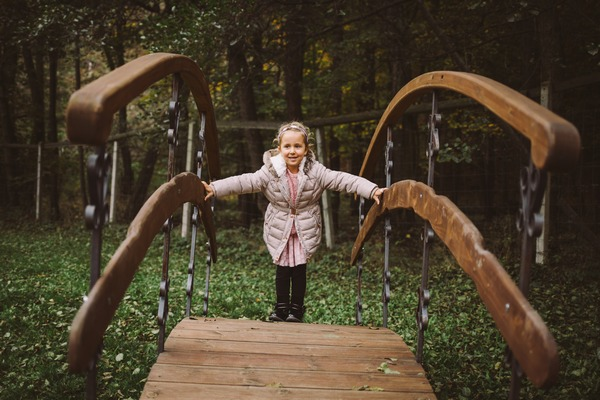 Flower girl standing on small bridge