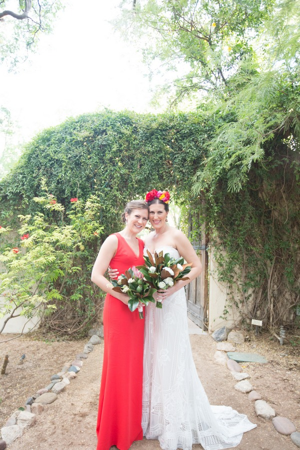 Bride with bridesmaid in red dress