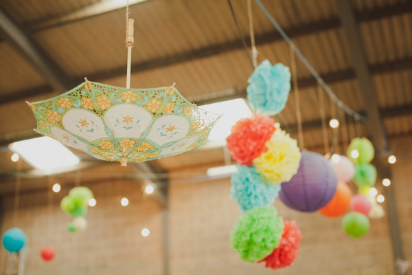 Umbrella and pom pom hanging from ceiling
