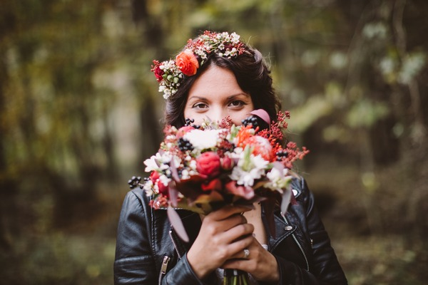 Bride holding bouquet in front of face