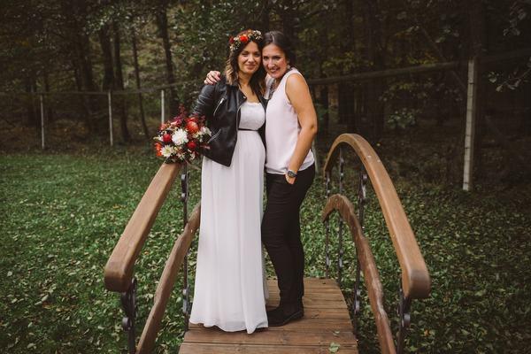 Bride and best friend on bridge