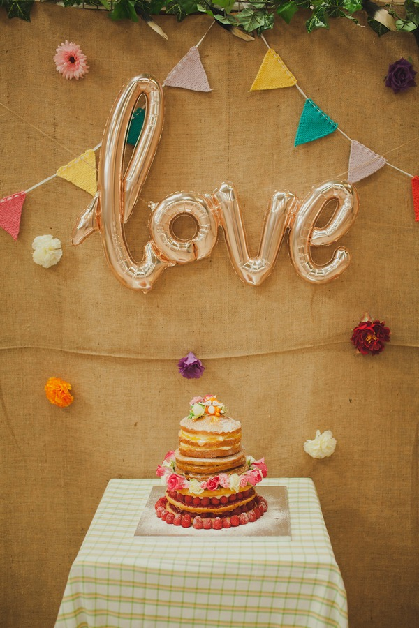 Love sign above wedding cake