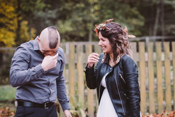 Groom getting leaves away from face