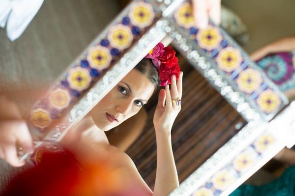Bride adjusting flower crown in mirror