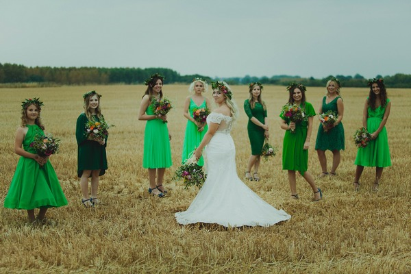 Bride and bridesmaids in corn field