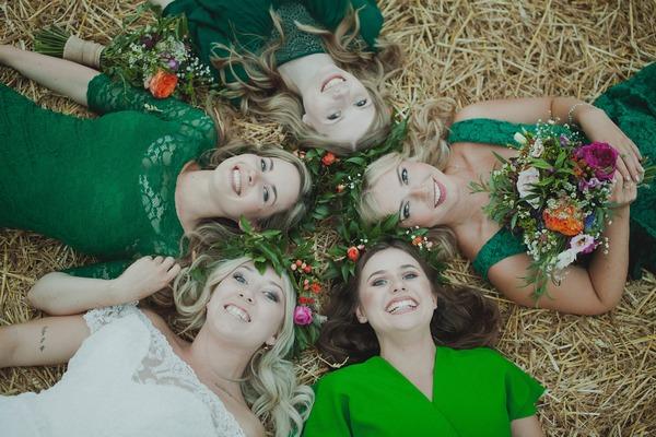 Bride and bridesmaids laying down