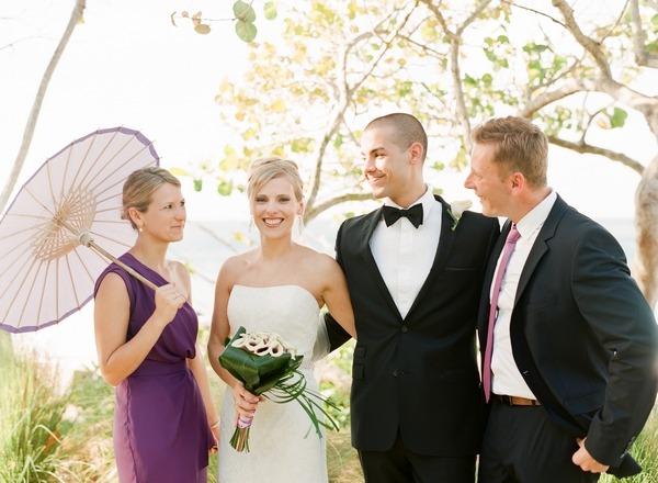 Bridesmaid holding parasol at Puerto Rico beach wedding