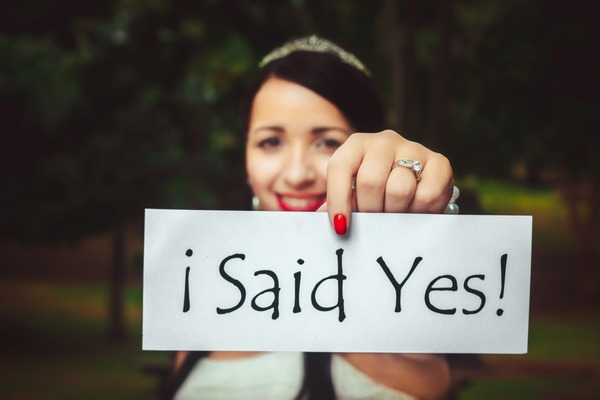 Bride holding I Said Yes sign