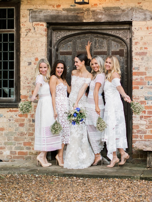 Bridesmaids wearing mismatched dresses