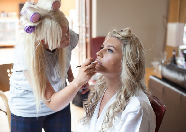 Bride having make-up done