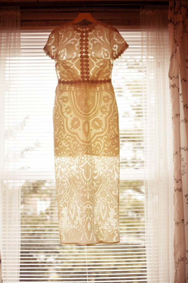 Wedding dress with crochet style pattern