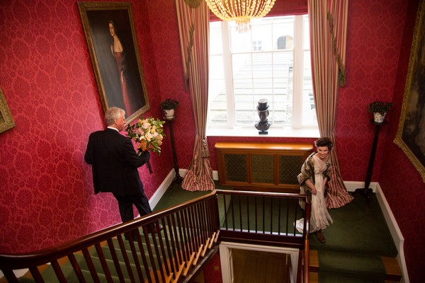 Bride and father walking down stairs at Bridwell