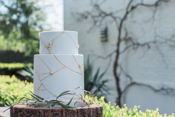 Wabi-sabi wedding cake with cracked icing design
