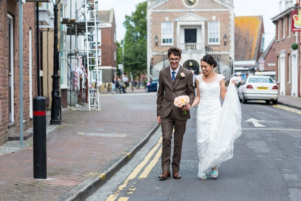 Bride and groom in road in Poole