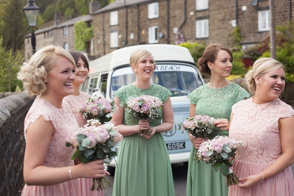 Bridesmaids in green and pink dresses