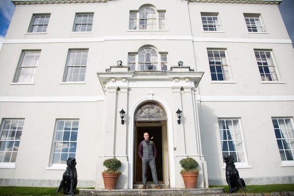 Groom at entrance to Bridwell wedding venue