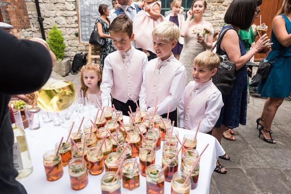 Children getting reception drinks at Scaplen's Court wedding