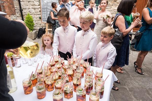 Children getting reception drinks at Scaplen's Court wedding