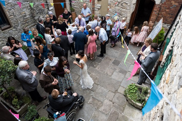 Wedding guests in courtyard at Scaplen's Court