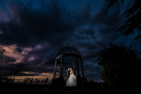 Bride and groom under Swancar Farm gazebo at night - Picture by Kimberley Hill Photography