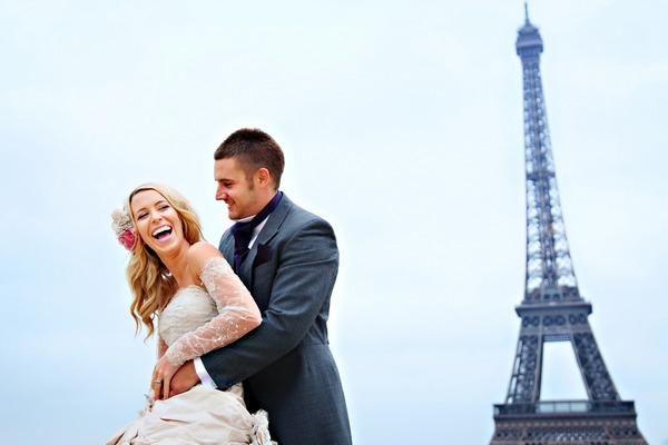 Bride and groom with Eiffel Tower in background - Picture by Martin Dabek Photography