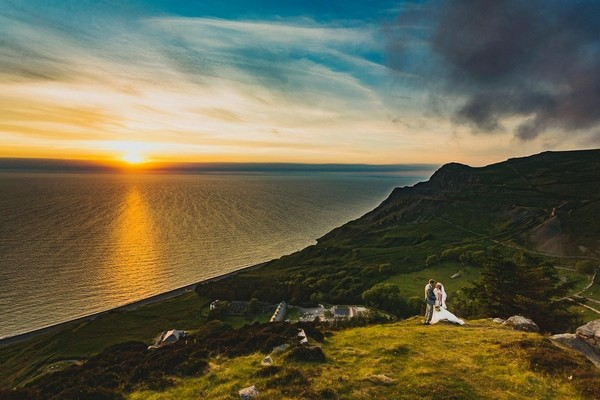 Bride and groom on hill by sea - Picture by Steve Gerrard Photography
