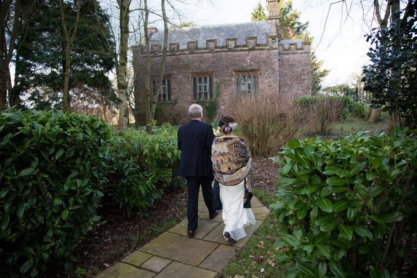 Bride and father walking to chapel at Bridwell
